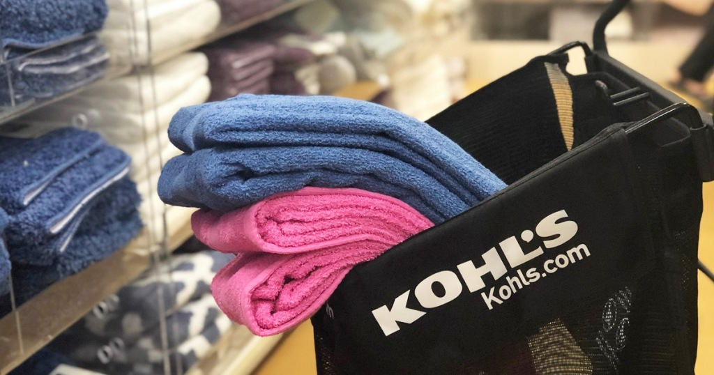 blue and pink bath towels inside a black kohl's shopping cart