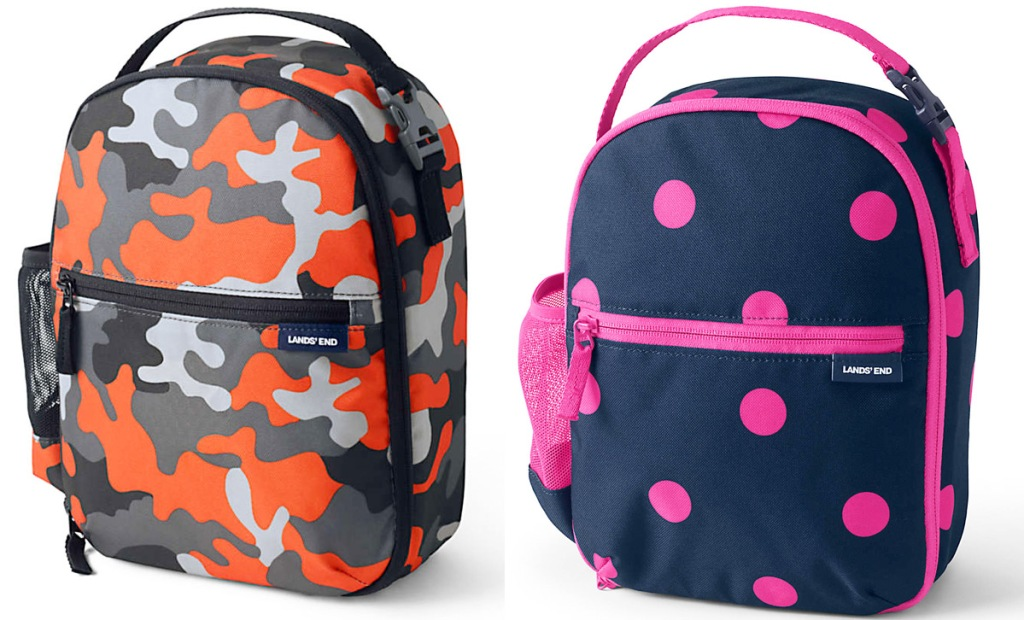 two kids lunch boxes in orange camo and navy and pink polka dot prints