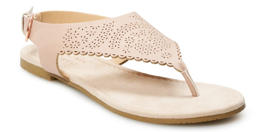 beige colored leather sandal with scalloped edges