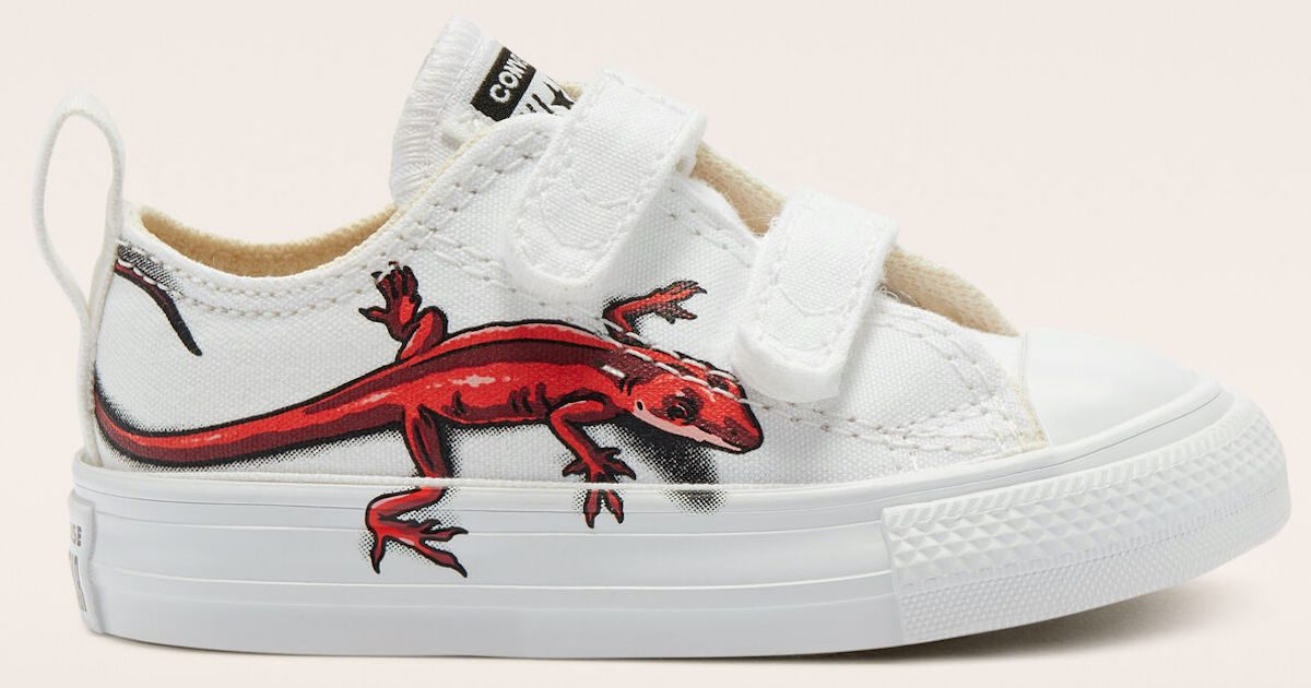 pair of kids white converse chucks with velcro and red lizard