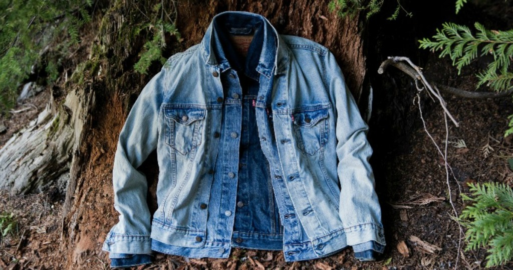 jean jacket leaning against a tree