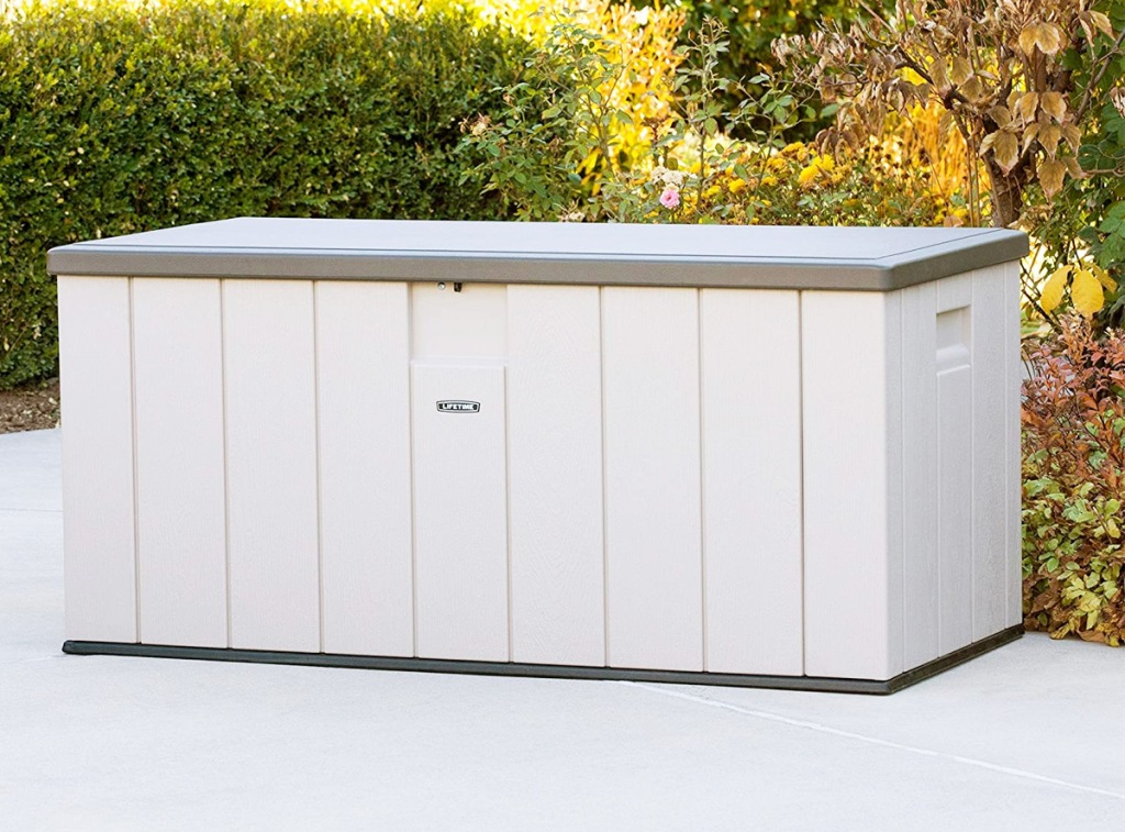 tand deck box with brown lid sitting on patio