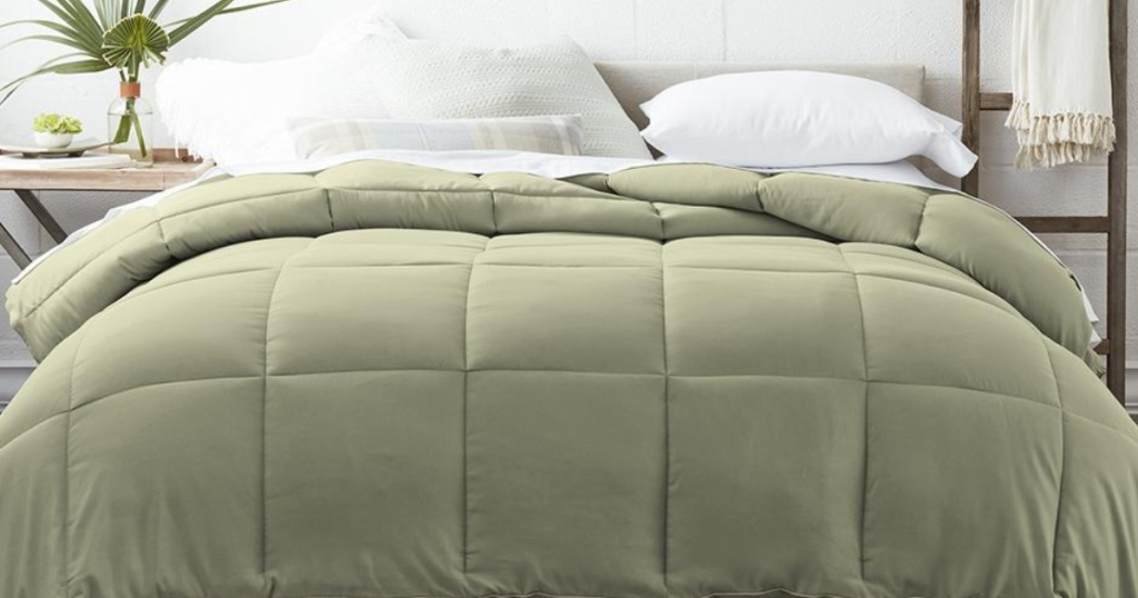 Moss Green Down alternative comforter on a bed with white fluffy pillows