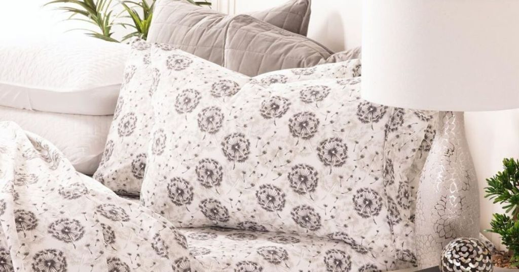 bed with patterned sheets on it