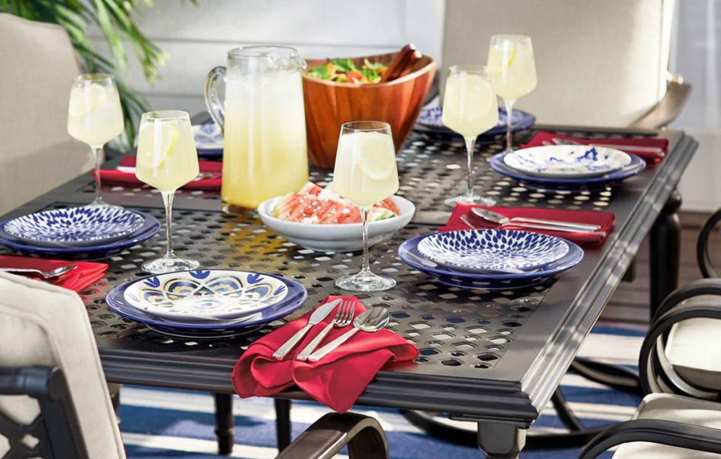 navy blue dinnerware set on an outdoor patio table with glasses of lemonade