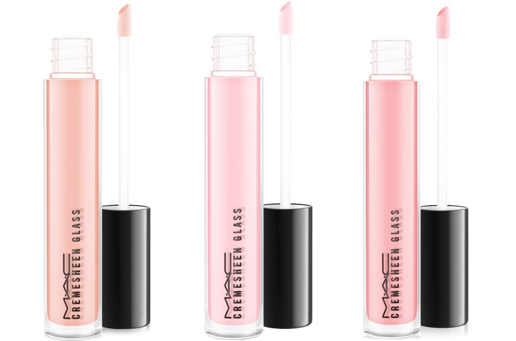 three sparkly mac lip glosses in light shades of pink and orange
