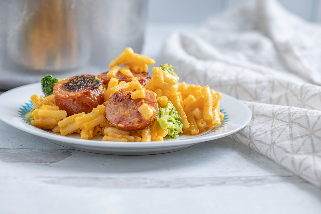 mac and cheese with sausage on plate