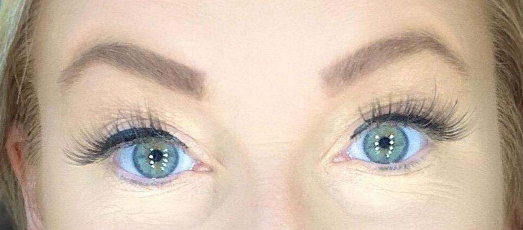 woman wearing fake eyelashes