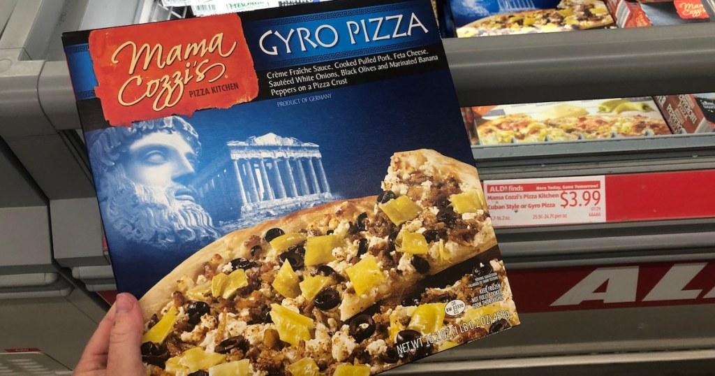 hand holding box of Mama Cozzi's Gyro Pizza Kit