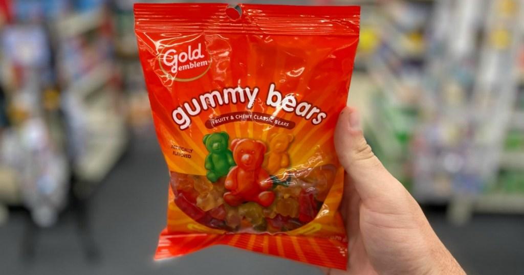 Man Holding Gold Emblem Gummy Bears