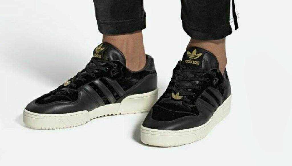 Man wearing Adidas Men's Originals Rivalry Low Shoes