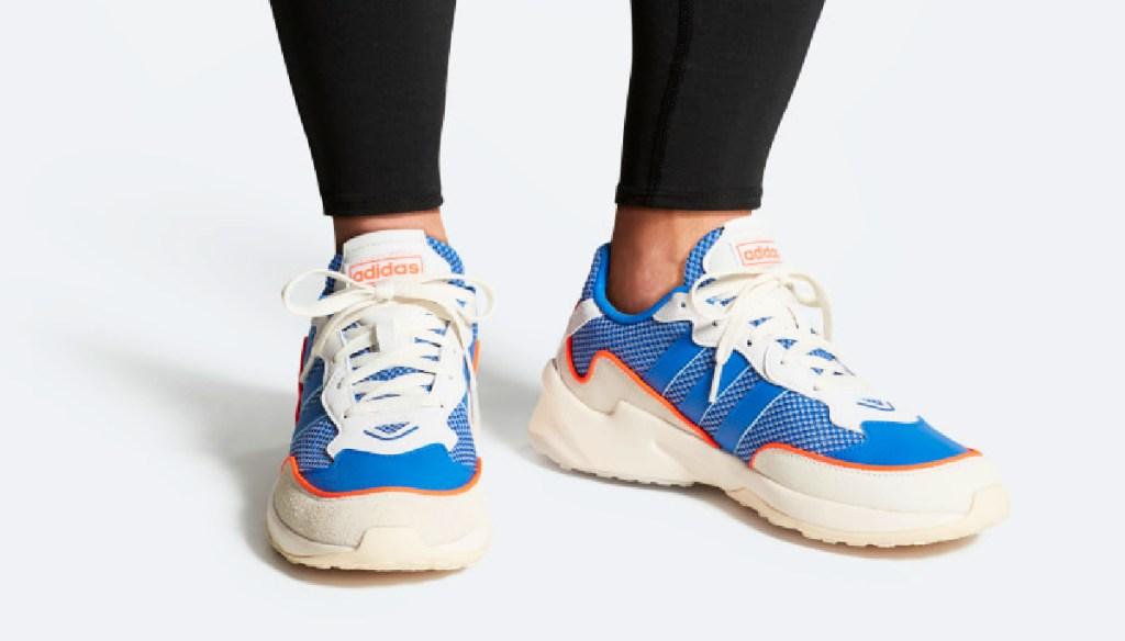 Man wearing Adidas Originals 20-20 FX Shoes in blue