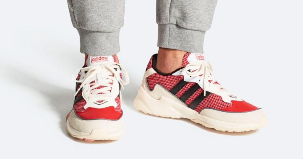 Man wearing Adidas Originals 20-20 FX Shoes