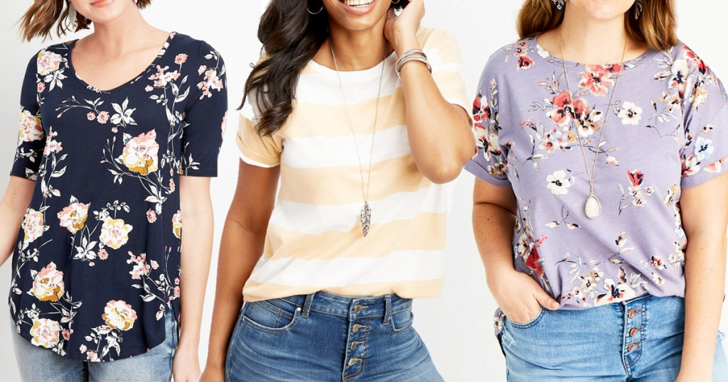 three women modeling tees in floral print and yellow and white stripes