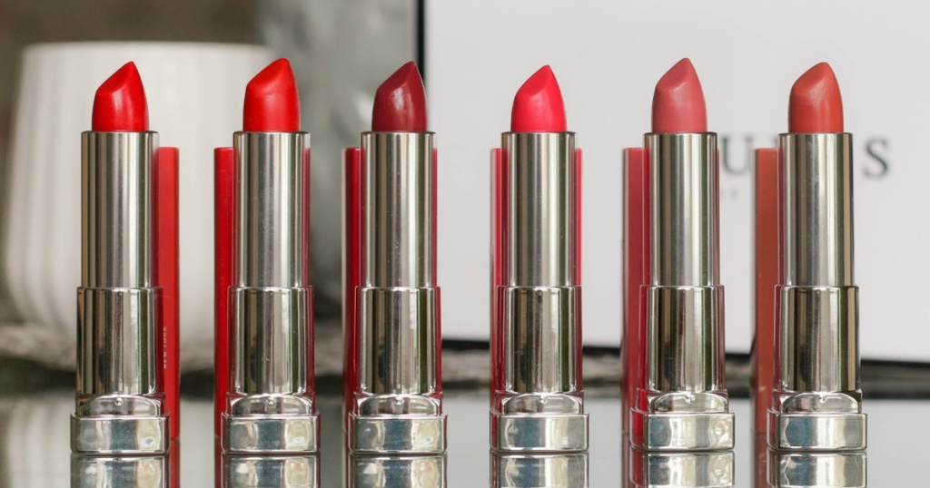 various colored lipsticks lined up on table