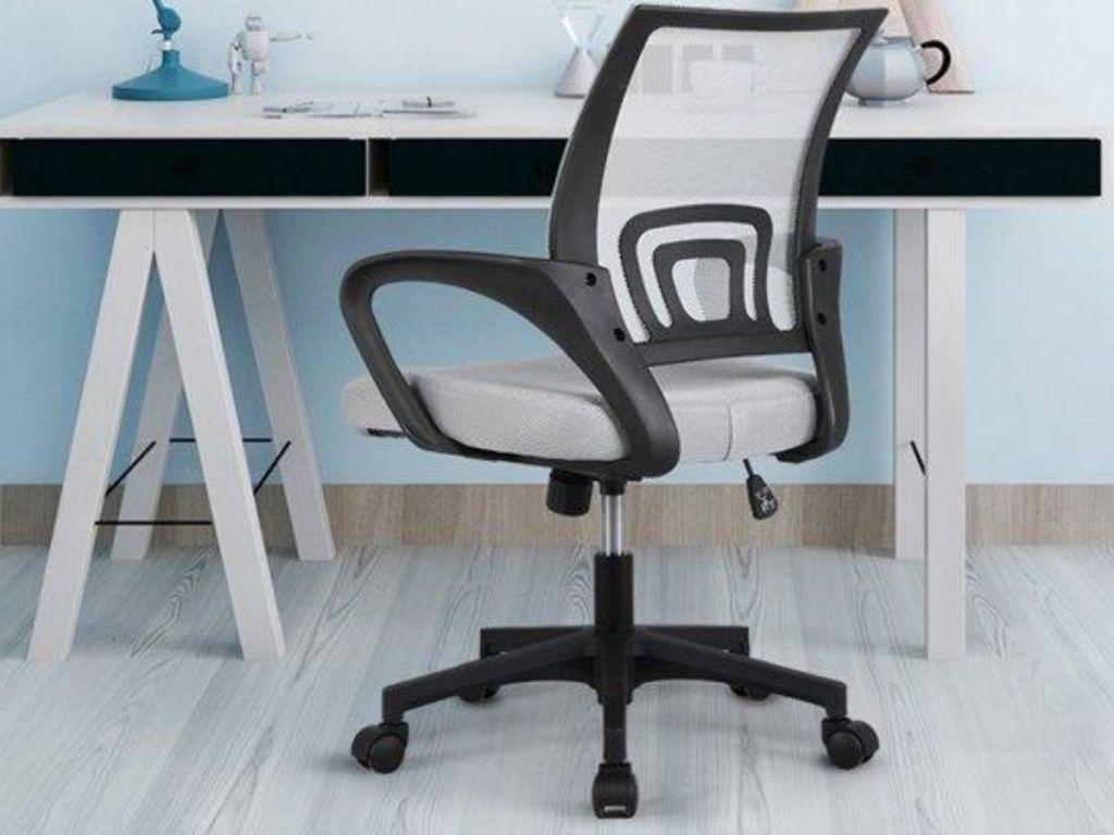mesh office chair at computer desk