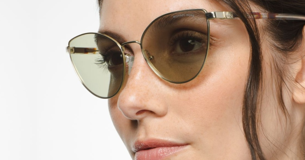 woman in brown gold sunglasses