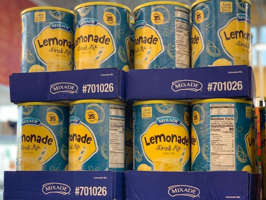 display of large containers of lemonade mix