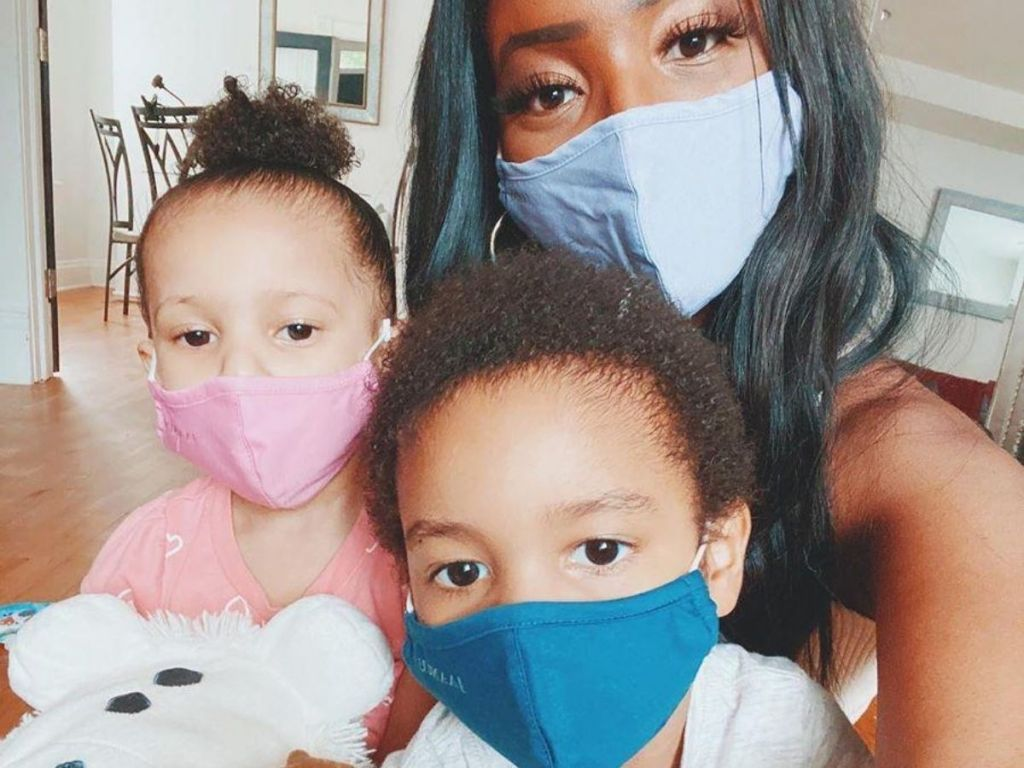mom and two kids wearing face masks