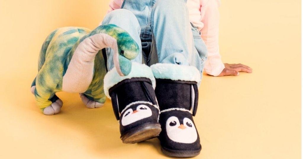 girl wearing penguin boots