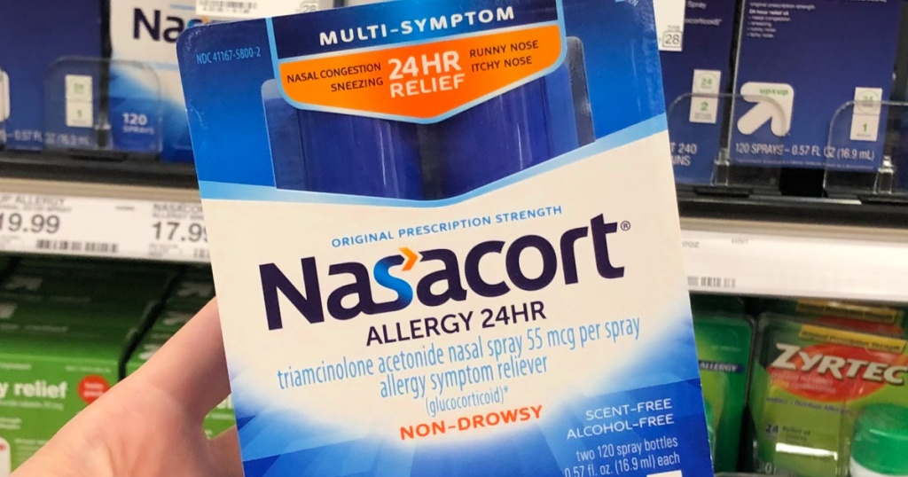 Nasacort allergy spray in person's hand at target