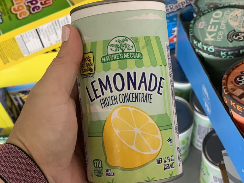 woman's hand holding can of frozen lemonade