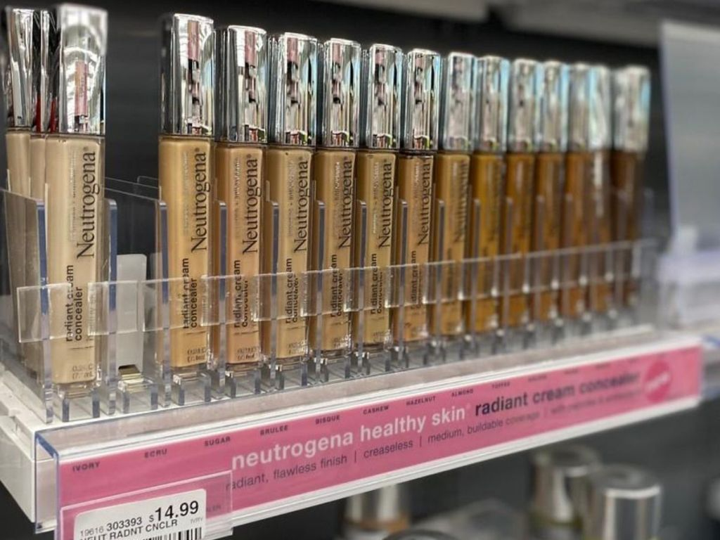 concealer sticks on shelf at store