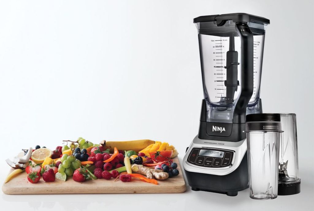 Ninja blender next to cutting board with vegetables