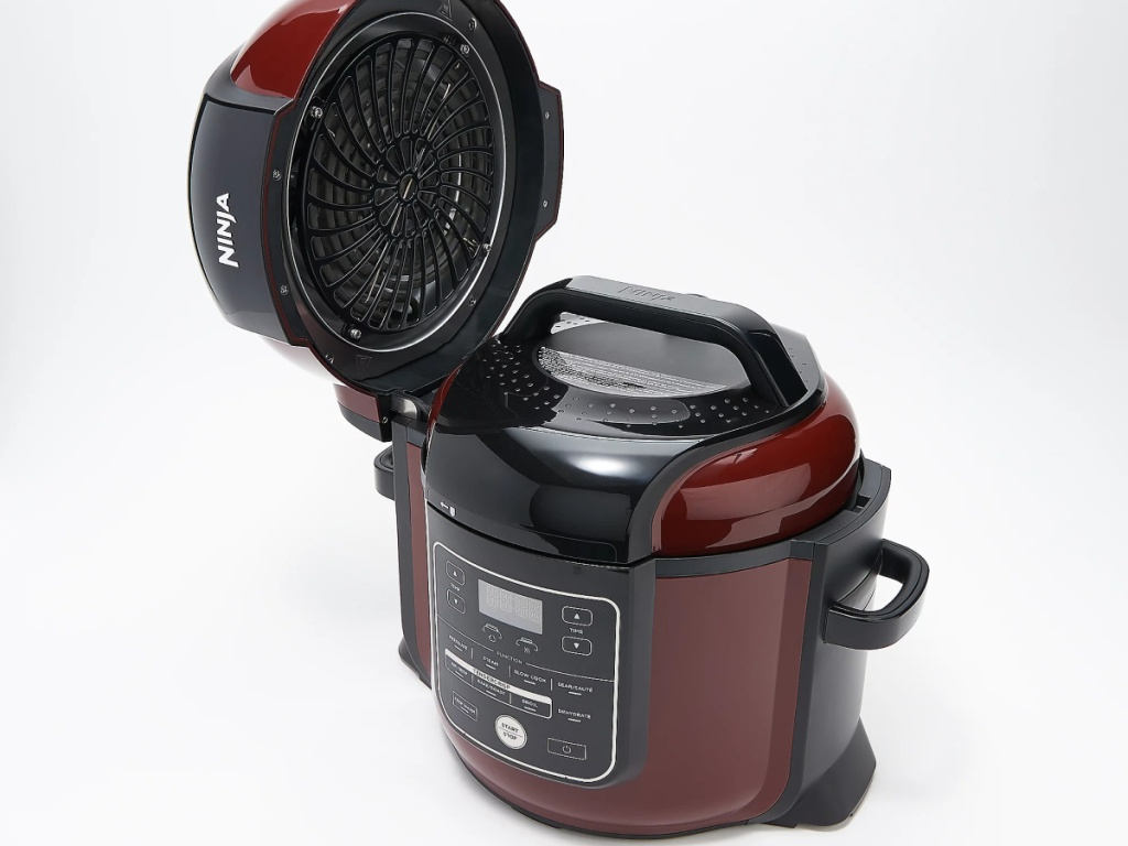 maroon kitchen appliance with open black lid