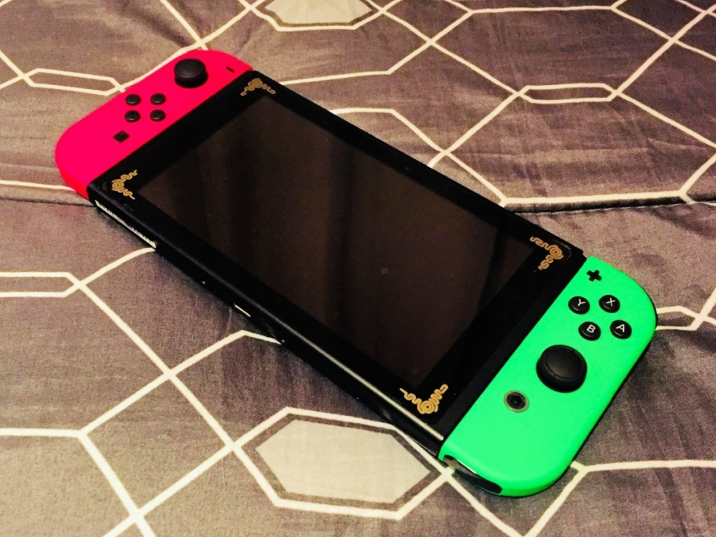Nintendo Switch with Joy-Cons in Neon Pink and Green