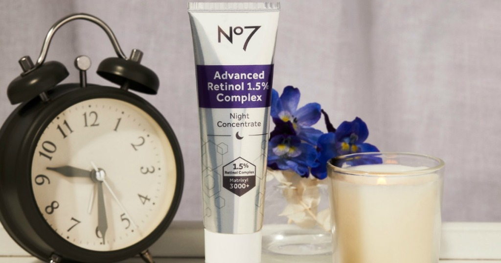 no7 retinol bottle next to plant and clock
