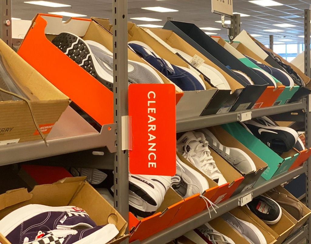 clearance rack full of boxes of boys sneakers
