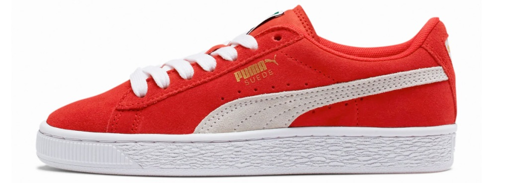 red shoe with white puma stripe down side and white rubber sole