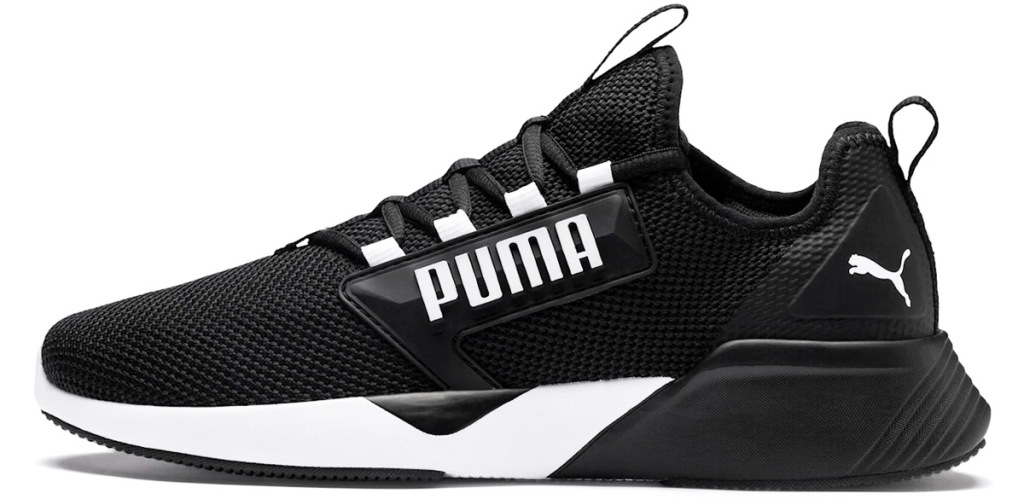 black puma shoes with black and white soles