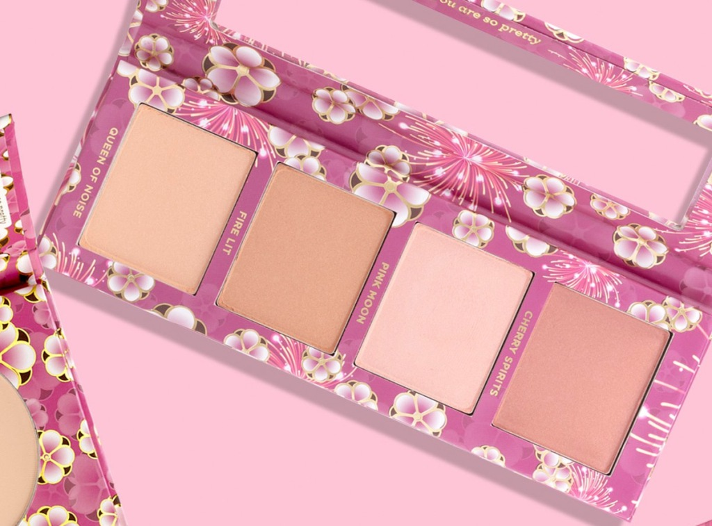 cheek palette with cherry blossom print on a pink background