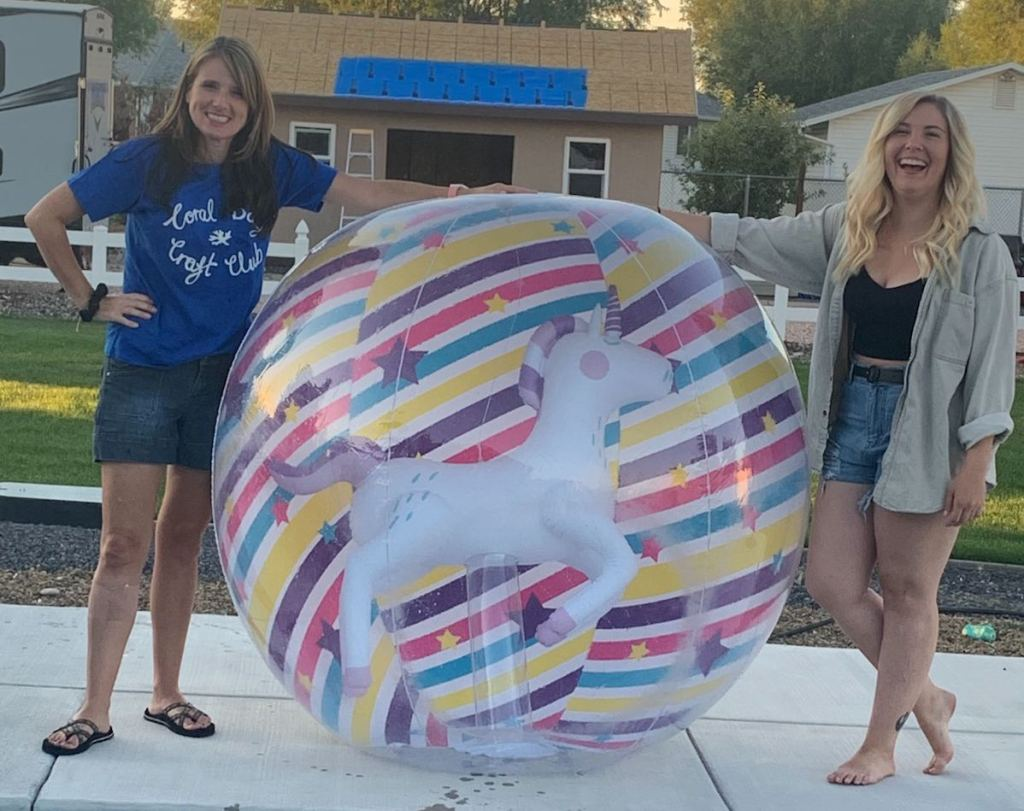 two women with giant beach ball