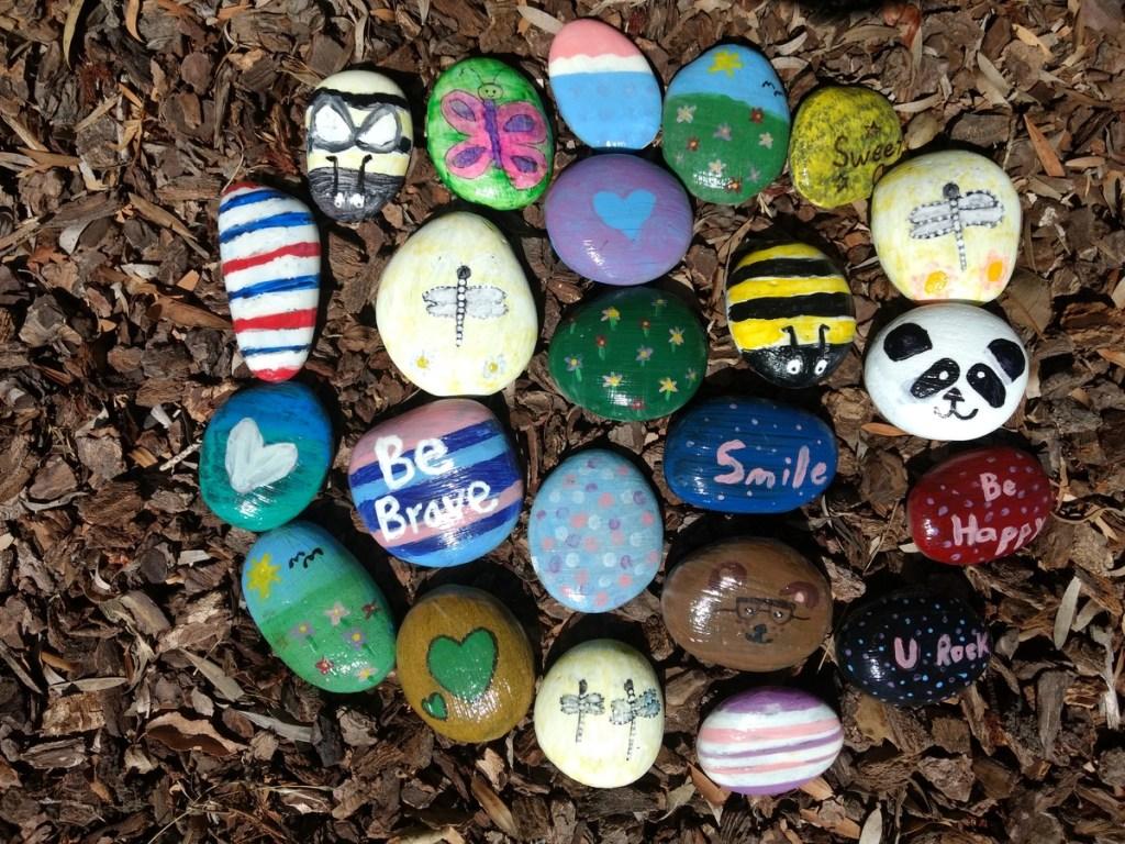 Painted rocks in mulch