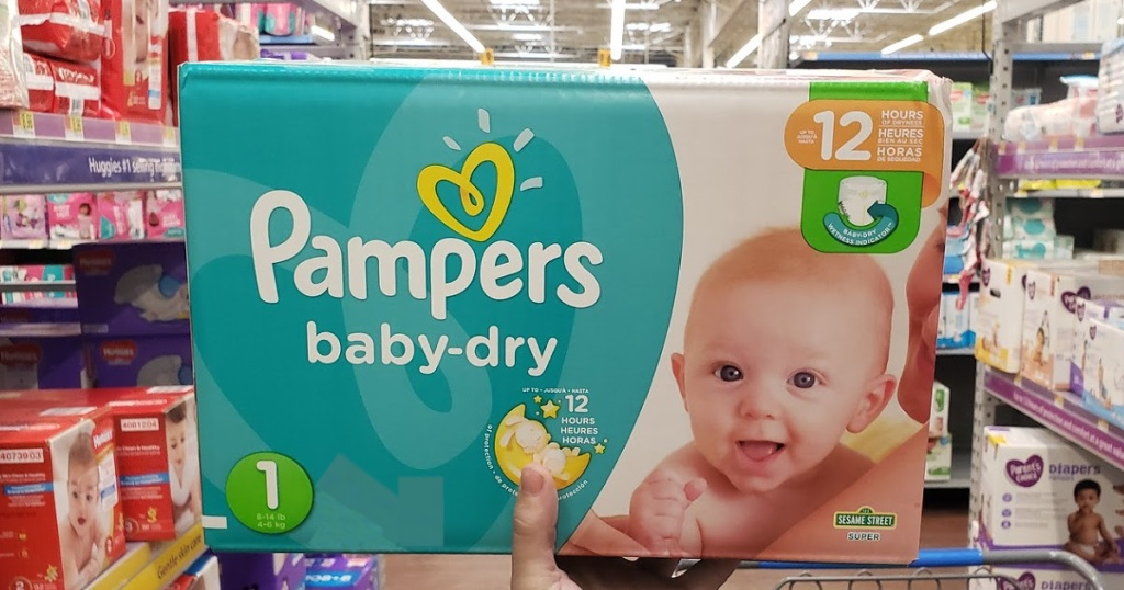 hand holding box of newborn diapers in store