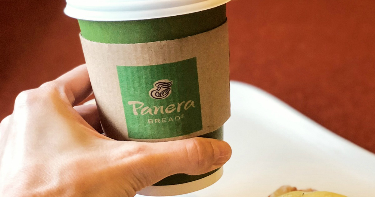 hand holding a Panera coffee cup