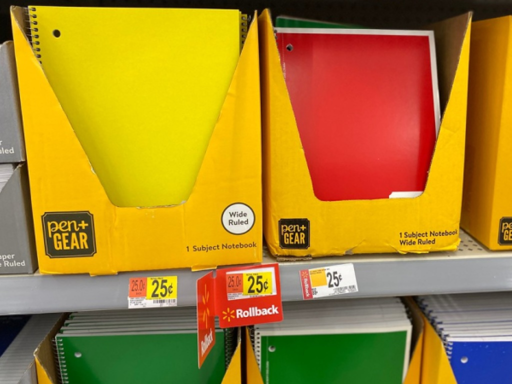 various colored notebooks on store shelf