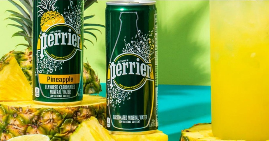 Perrier Mineral Water on table next to pineapple