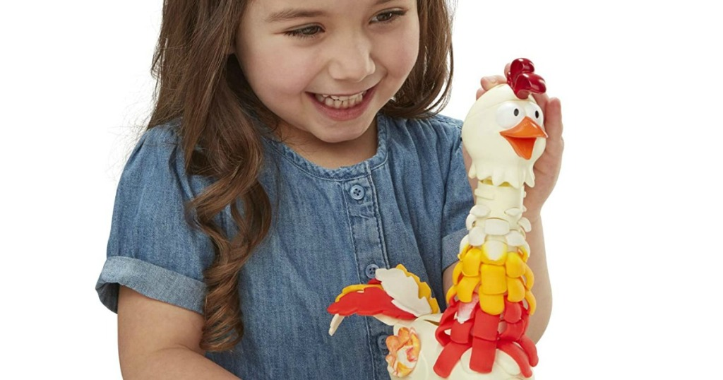 girl playing with Play-Doh chicken set