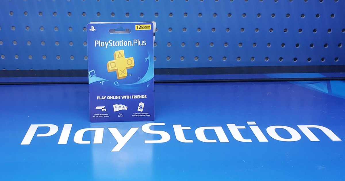 playstation plus gift card sitting on top of a blue playstation sign