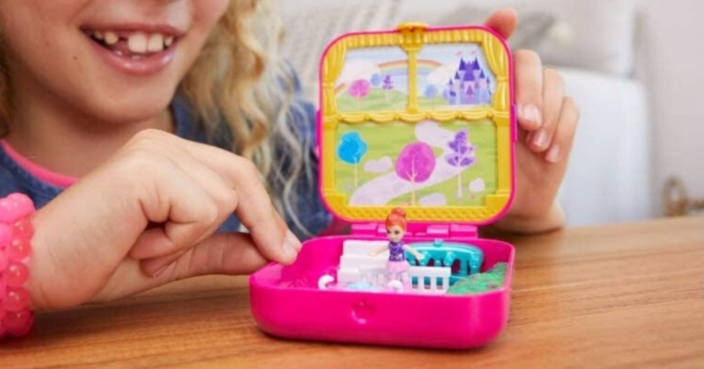 Young girl playing with a classic Polly pocket toy