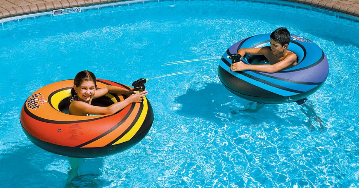two kids in inflatable inner tubes in a pool
