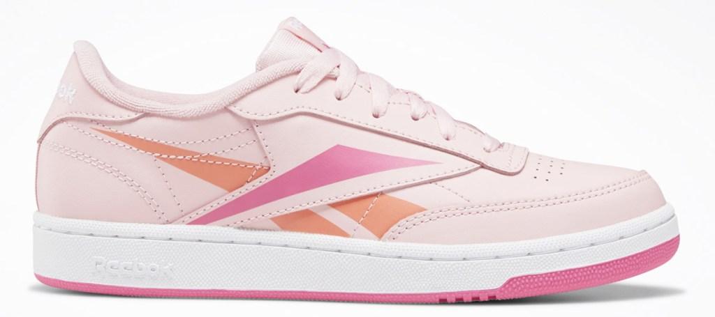 pink reebok sneaker with pink and orange reebok logo on side