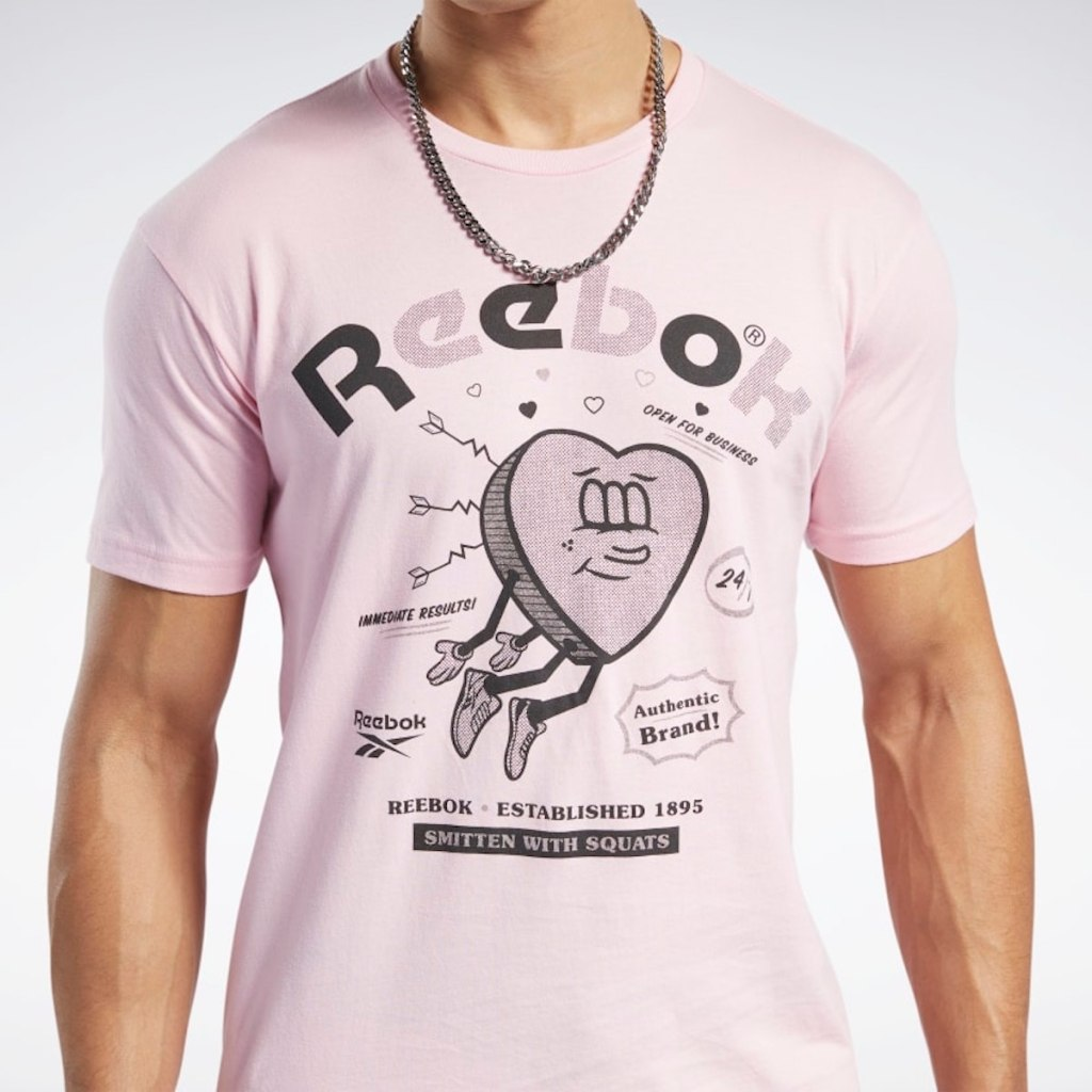 man wearing light pink reebok shirt with heart on it