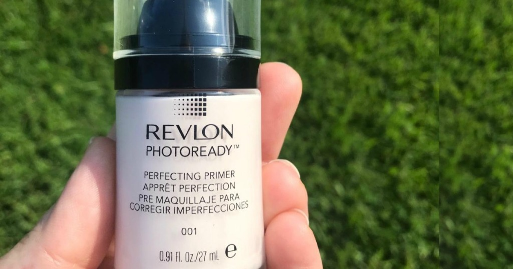 woman holding Revlon PhotoReady Primer