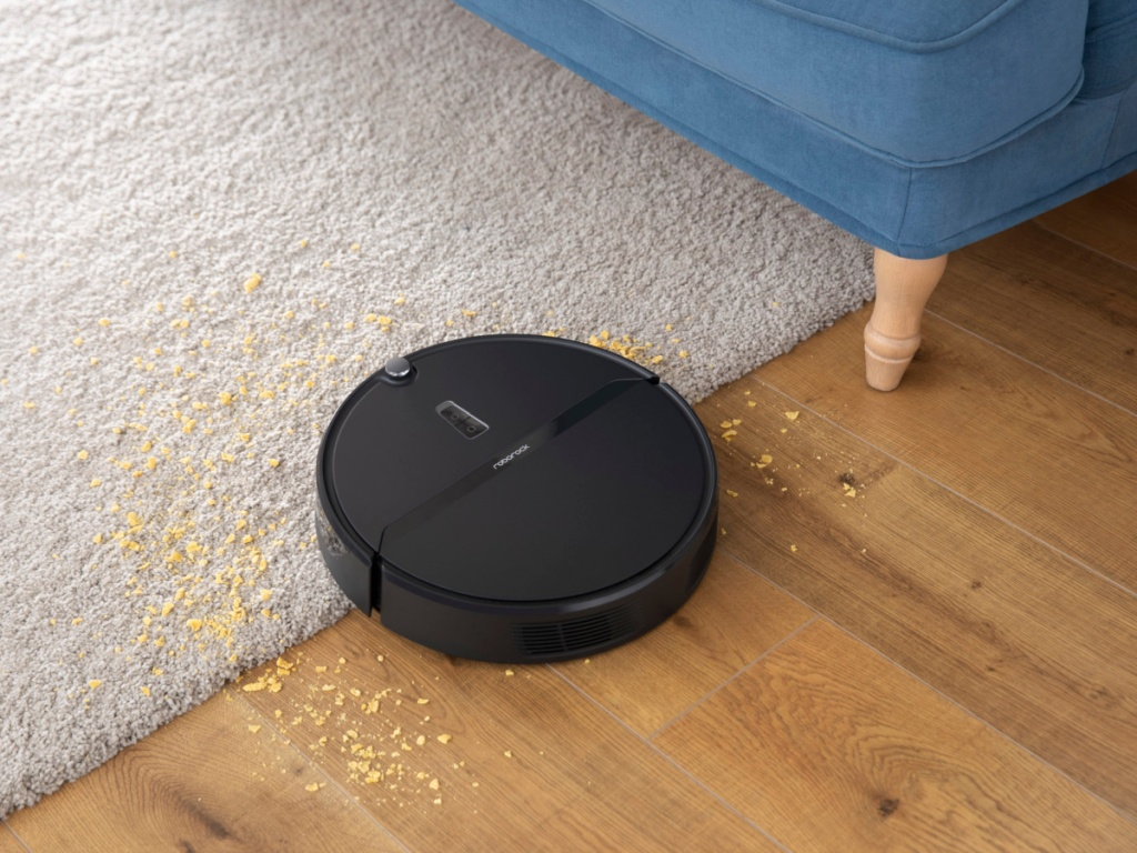 Roborock E4 Robot Vacuum Cleaner vacuuming up crumbs from floor