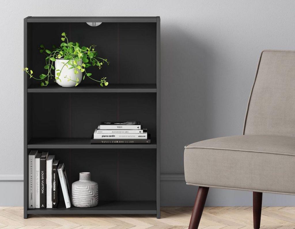 bookshelf next to chair